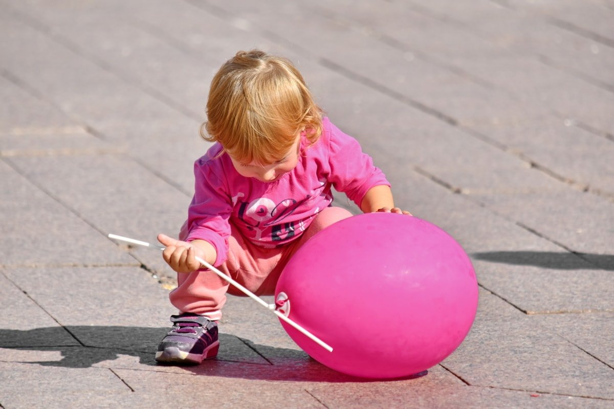 Baby Playing With Balloon