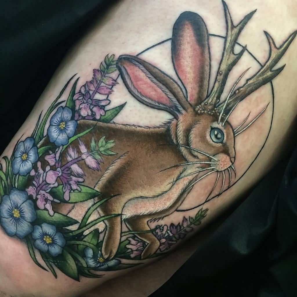 Color Flowers And Jackalope Tattoo On Leg