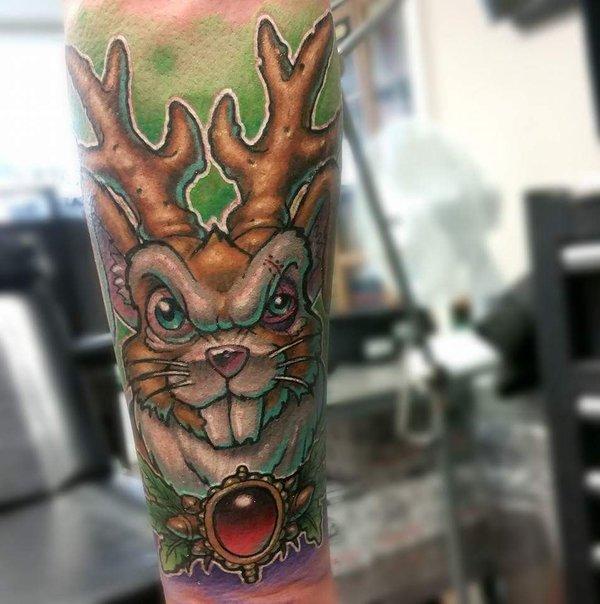 Red Gem Jackalope Tattoo On Sleeve